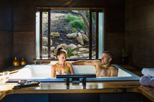 Couple bathing at hot springs